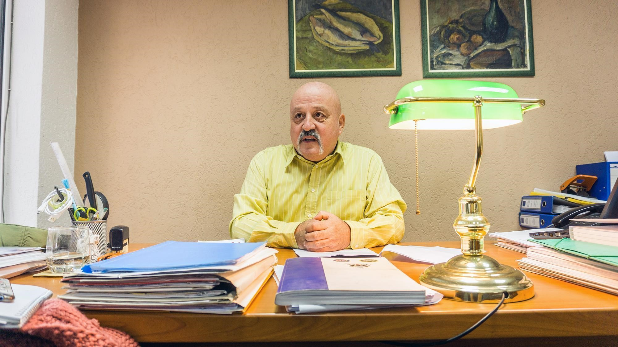 Nebojsa Vlajic, friend and lawyer of the late Oliver Ivanovic, discusses violence in northern Kosovo at his office in Mitrovica. Photo: Stefan Milivojevic